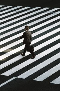 Photograph of businessman on zebra crossing UK Innovator Visa