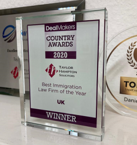 photo of Taylor Hampton Immigration department's awards Trophy