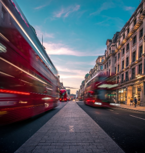 London city stree with buses moving fast