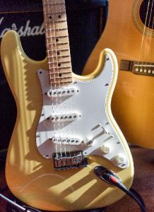 Photo of guitar in sunlight