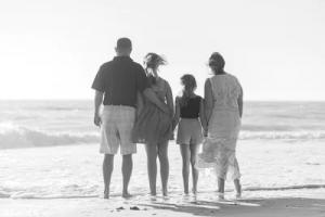 photograph of family on beach eea famiy members