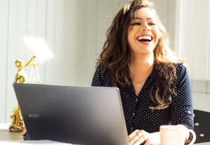 Female at her computer laughihng